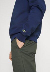 Lacoste - Sweatshirt - scille - 4