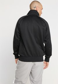 Puma - ICONIC TRACK - Sweat à capuche zippé - black - 2