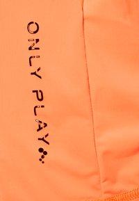 ONLY Play - ONPPERFORMANCE TRAINING LOOSE - T-shirt basic - sunset orange/black - 2