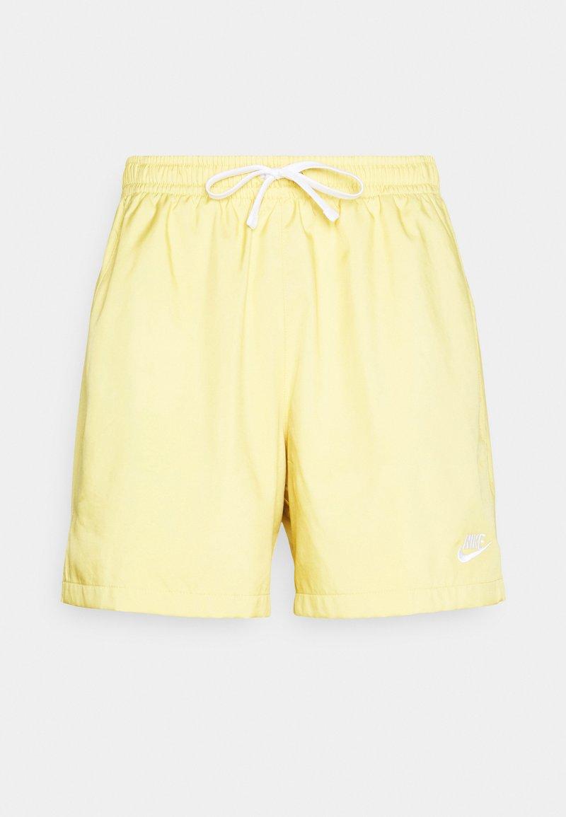 Nike Sportswear - FLOW - Shorts - saturn gold