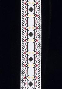 MCM - GEO LAUREL TRACK PANT IN VELOUR - Tracksuit bottoms - black - 3