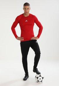 adidas Performance - Sports shirt - powred - 1