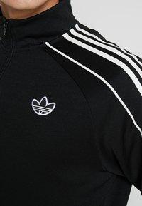 adidas Originals - FSTRIKE - Chaqueta de entrenamiento - black - 3
