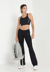 Casall - JAZZPANTS - Spodnie treningowe - black - 1
