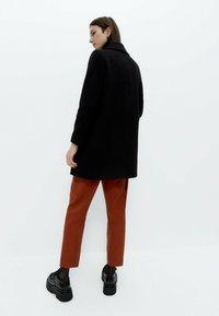 Uterqüe - Short coat - black - 2