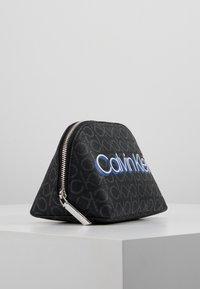 Calvin Klein - MONOGRAM MAKE UP BAG - Trousse de toilette - black - 4