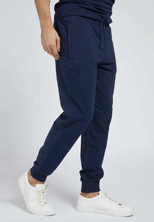 Pantalones deportivos - blau