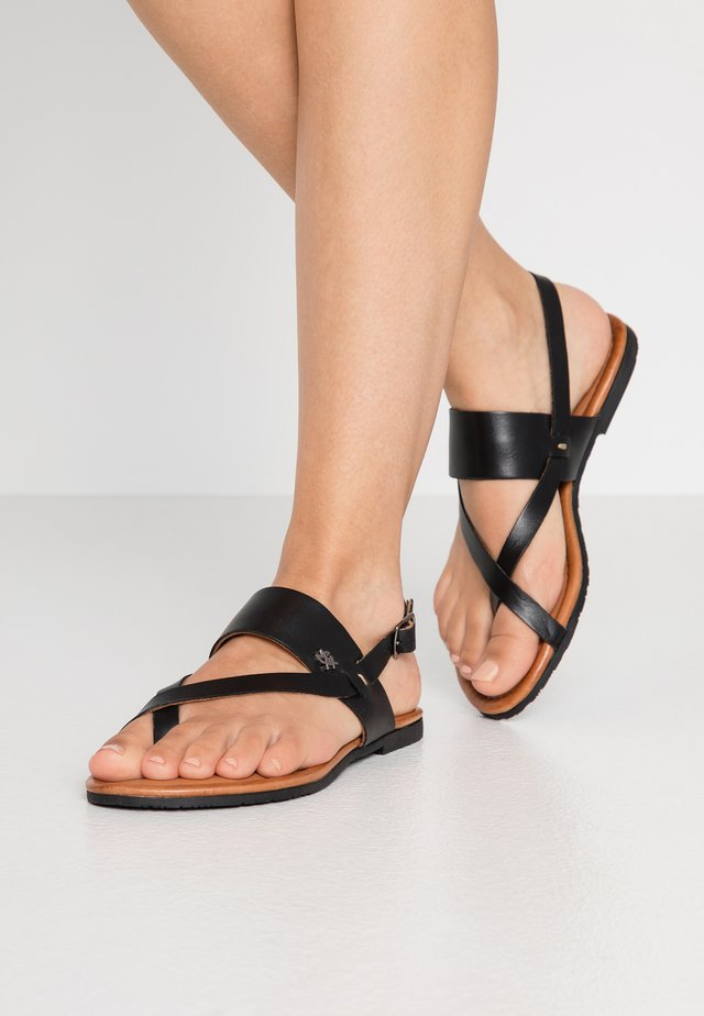 EVELINN - T-bar sandals - black