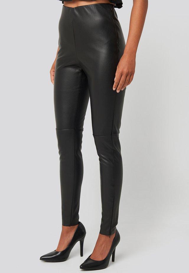 PU ZIPPER PANTS - Legging - black