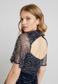 Maya Deluxe - HIGH NECK MAXI DRESS WITH OPEN BACK AND SCATTERED SEQUIN - Suknia balowa - navy - 6