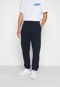 Hollister Co. - RELAXED JOGGER - Tracksuit bottoms - navy - 0