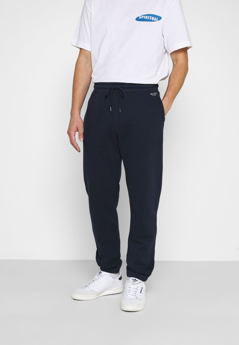 Hollister Co. - RELAXED JOGGER - Tracksuit bottoms - navy