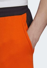 adidas Originals - ADVENTURE FIELD JOGGERS - Tracksuit bottoms - orange - 4