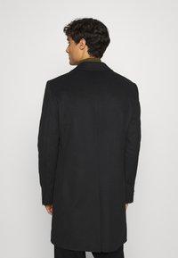 Tommy Hilfiger Tailored - BLEND COAT - Klassinen takki - black - 2