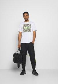 adidas Performance - URBAN PANT - Jogginghose - black/neon green - 1