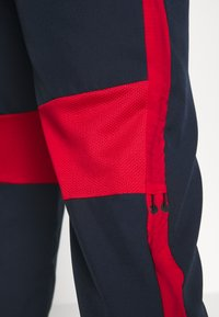 Nike Performance - DRY ACADEMY PANT - Tracksuit bottoms - obsidian/university red/white - 5