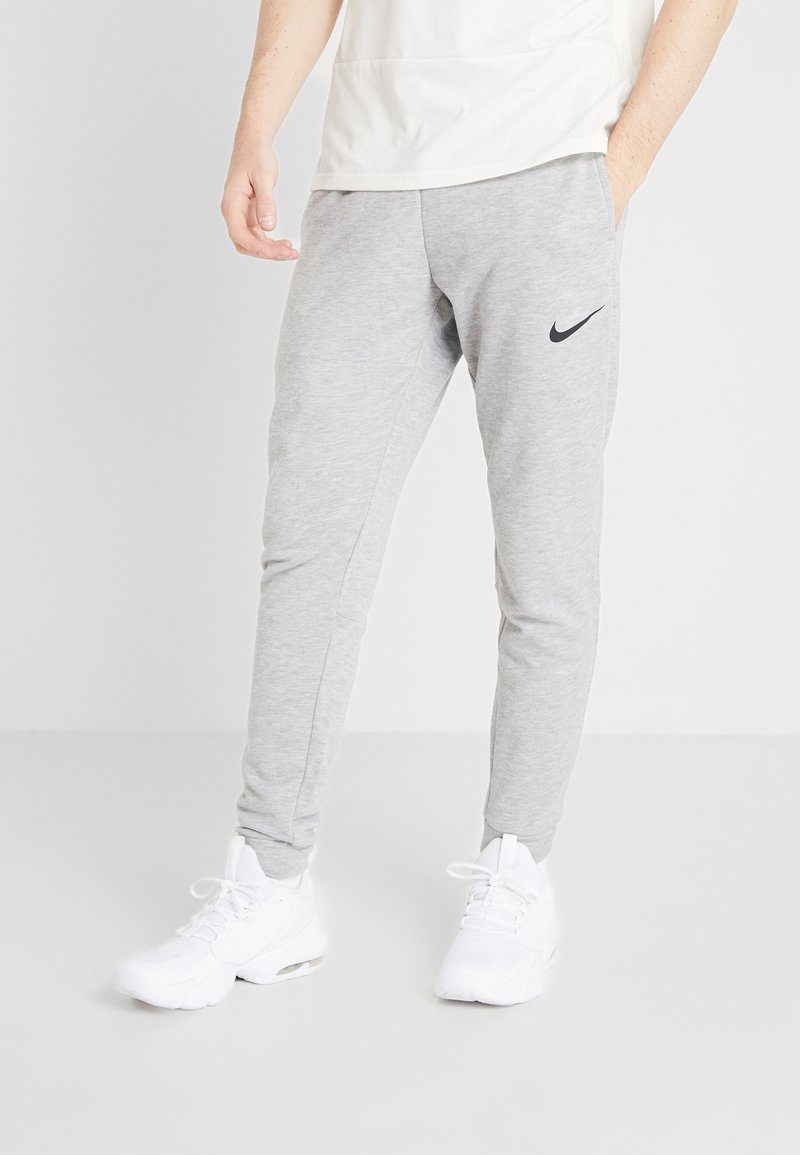 Nike Performance - DRY PANT TAPER - Spodnie treningowe - grey heather