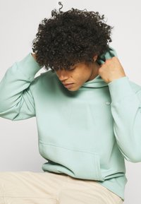 adidas Originals - PREMIUM HOODY UNISEX - Sweatshirt - hazy green - 4