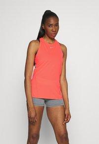 Nike Performance - TANK ALL OVER  - Sports shirt - bright mango/white - 0