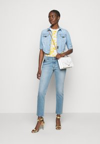 Versace Jeans Couture - JEANS - Jeans Skinny Fit - indigo - 1