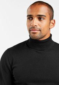 Next - Stickad tröja - black - 2
