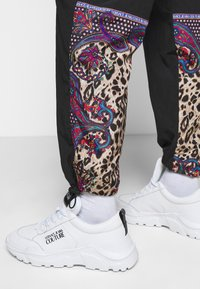 Versace Jeans Couture - CRINKLE  - Tracksuit bottoms - nero - 3