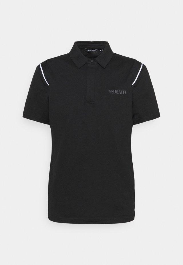 SLIM FIT LOGO PRINT - Polo shirt - nero
