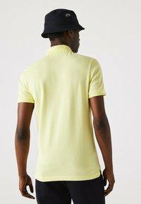 Lacoste - Polo shirt - jaune - 1