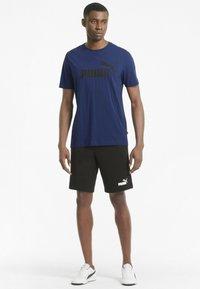 Puma - ESSENTIALS LOGO MAND - Print T-shirt - elektro blue - 1