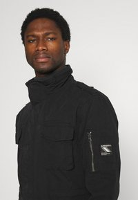 Superdry - CLASSIC ROOKIE  - Summer jacket - washed black - 3
