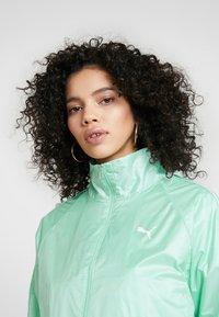 Puma - EVIDE JACKET - Waterproof jacket - mist green - 4