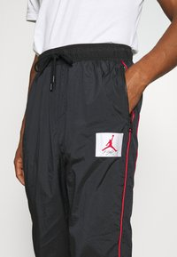Jordan - FLIGHT WARMUP PANT - Trainingsbroek - black/university red - 4