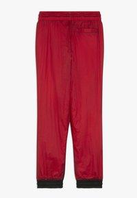 Jordan - WINGS SIDELINE PANT - Tracksuit bottoms - gym red - 1