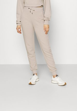 FIT - Tracksuit bottoms - beige