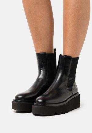 GRENORA - Platform ankle boots - black