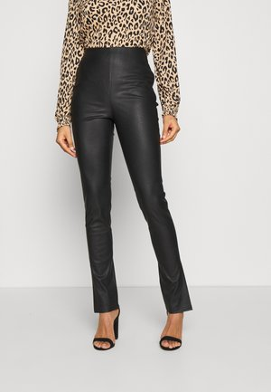 SIDE SLIT  - Trousers - black