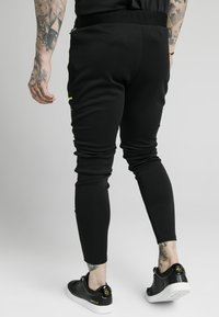 SIKSILK - LEGACY FADE TRACK PANTS - Tracksuit bottoms - black - 2