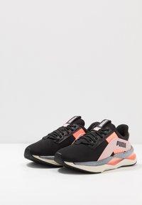 Puma - LQDCELL SHATTER XT GEO - Sports shoes - black/peachskin/peach - 2