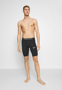 Nike Performance - SHORT LONG - Trikoot - black - 0