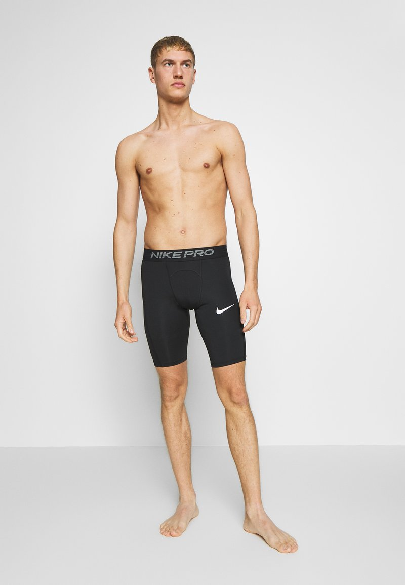 Nike Performance - SHORT LONG - Medias - black
