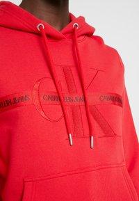Calvin Klein Jeans - TAPING THROUGH MONOGRAM HOODIE - Hoodie - racing red - 5