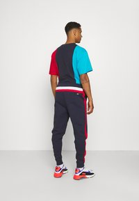 Tommy Jeans - MIX MEDIA BASKETBALL PANT - Tracksuit bottoms - twilight navy - 2