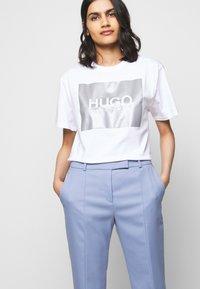 HUGO - HERLENE - Trousers - bright blue - 4