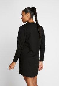 Puma - NU TILITY DRESS - Vestido de deporte - black - 2