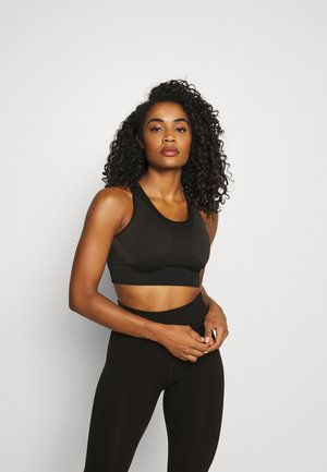 THE MOTION SEAMLESS - Sport-bh met light support - black