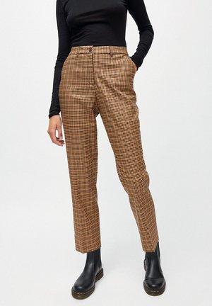 HERTTAA - Trousers - brown