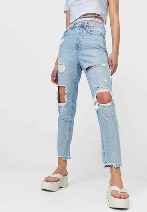 MIT SCHLITZEN  - Jeans Slim Fit - light blue