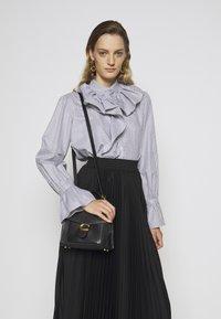 Coach - TABBY TOP HANDLE - Handbag - black - 0