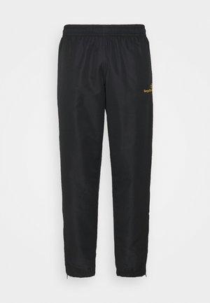 CARSON PANTS - Verryttelyhousut - black/gold