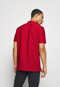 Nike Golf - DRY SPEED - Funkční triko - gym red/white - 2